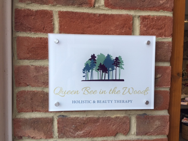 Outside Sign for Queen Bee in the Woods Beauty Salon